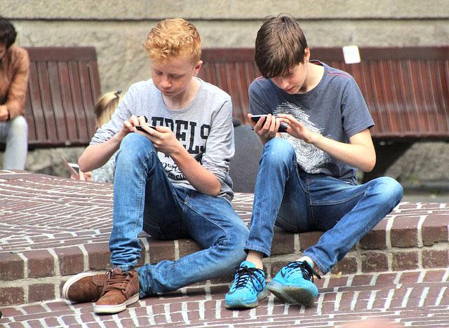 Teens playing Pokemon Go