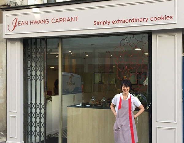 Jean Hwang Carrant in front of her store
