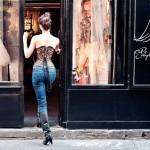 Woman in corset entering shop.