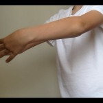 Boy's arms in ballet pose