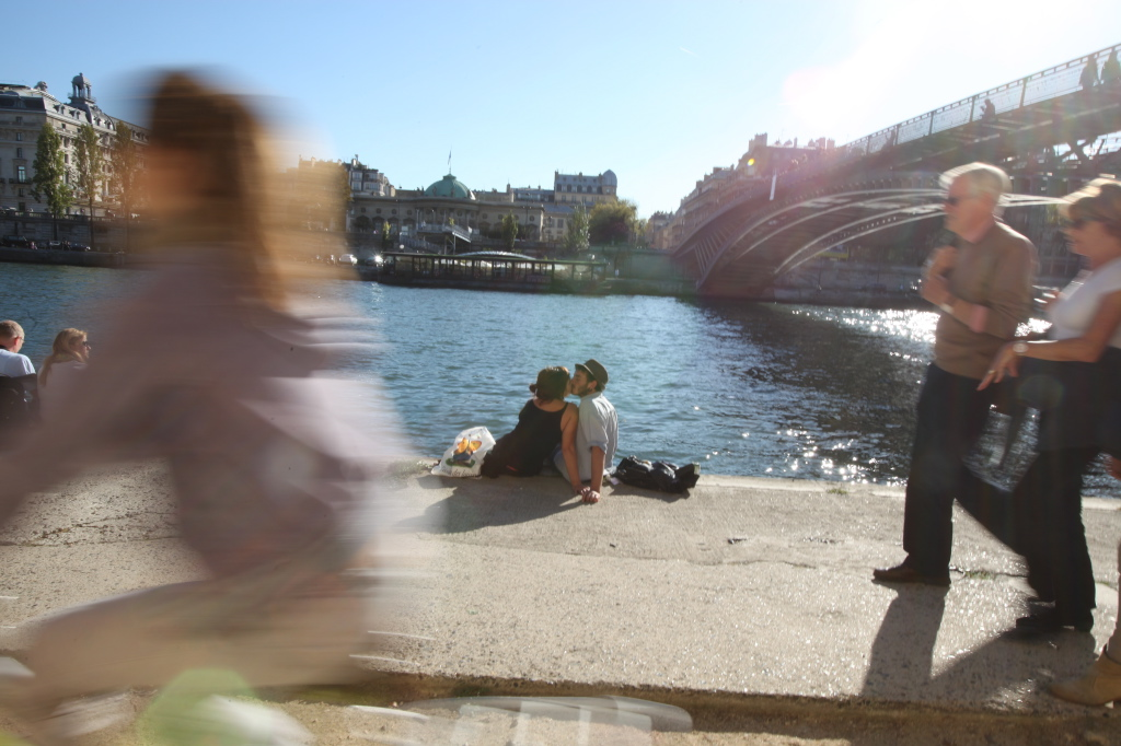 Love is in the air along the banks of the Seine River.