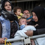 Refugees prepare to land at Messina port, Italy. Photo: UNHCR/Fabio Bucciarelli
