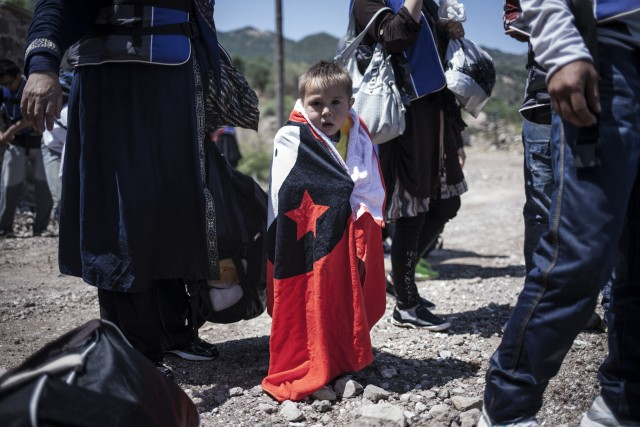 Young refugee boy arrives in Greece. Photo: UNHCR/Socrates Baltagiannis