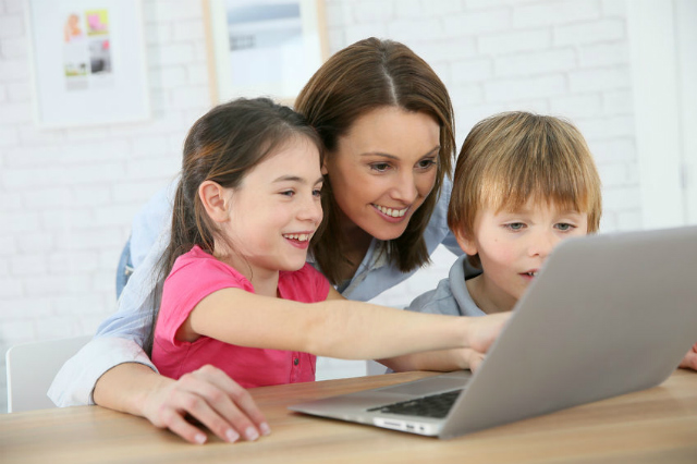 Mother playing with child on computer