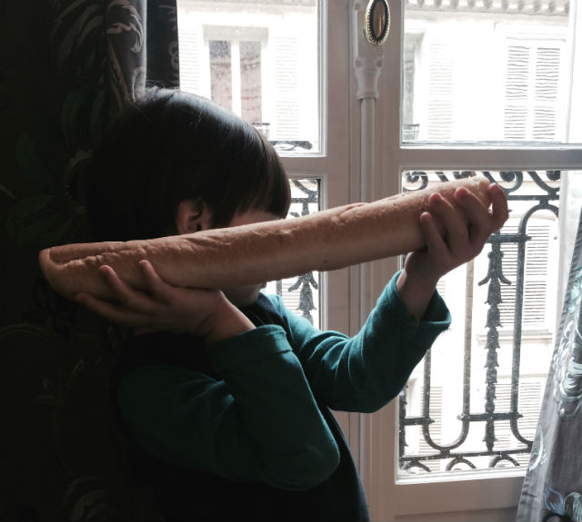 child with food allergies holding baguette