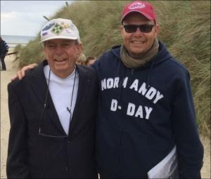 Trevor Standefer with Veteran on D-Day Tour. Photo courtesy of author.