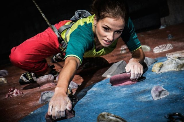 work life balance - woman rock climbing