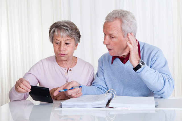 senior couple calculating financial risk