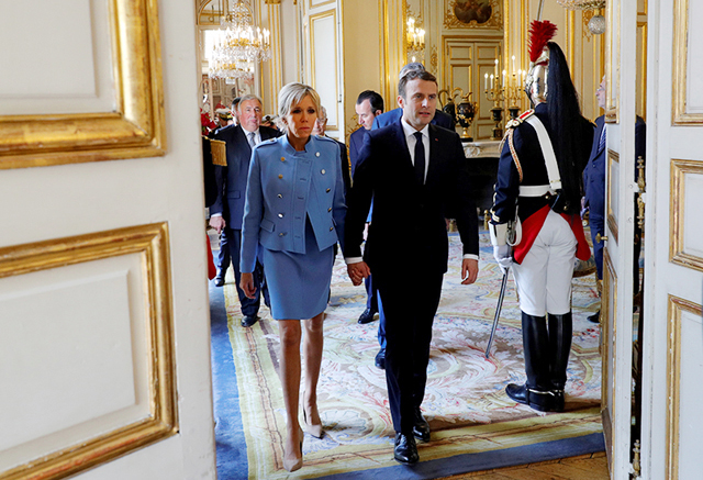 French President Emmanuel Macron And His Wife Brigitte Trogneux Walk In The Elysee Palace During The Handover Ceremony In Paris Inspirelle